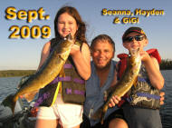 Seanna and Hayden with grandpa GiGi with two of 400 walleye they caught that day.